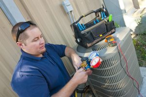 air-conditioning-maintenance-technician-checks-mainfold