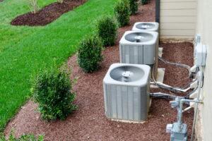 air-conditioner-units-near-grass